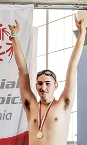 Ian Wolfe receives one of three gold medals he earned in the pool at the Special Olympics Virginia 2016 State Games. His events included the 25-meter breaststroke, 50-meter backstroke and 50-meter freestyle.
