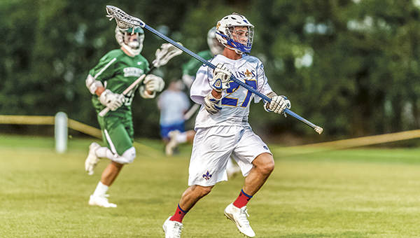 Nansemond-Suffolk Academy's Reed Browne runs with the ball in a lacrosse game against Trinity High School. Browne received first-team TCIS honors as well as first-team All-State.