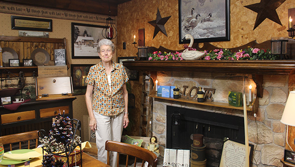 Joan Parsons Mayo shows off part of the Knot Hole Station shop in Driver. Mayo opened the shop in 1976, so it is celebrating its 40th anniversary this year.