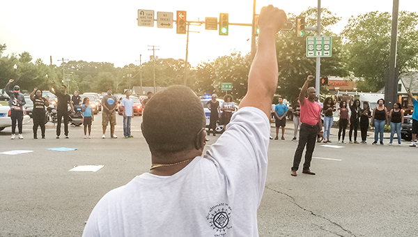 Protestors form a circle in the intersection of North Main Street and Constance Road about 7:25 p.m. Monday evening.