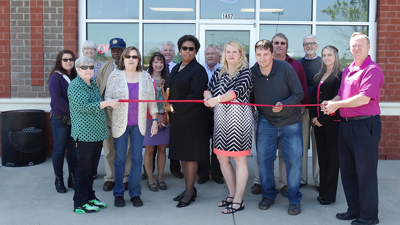 Anita Justice, owner and agent at AJ Southern Insurance Agency in Franklin, cuts the ribbon to officially open her office there during a recent ceremony.