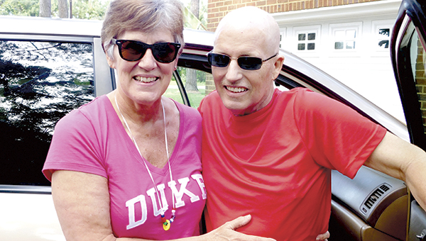 Terry and Greg Ryan arrive home after a trip from Duke University Hospital on Tuesday. Greg Ryan, pastor at Oakland Christian United Church of Christ, fell ill while on vacation in Hawaii and has been diagnosed with leukemia.