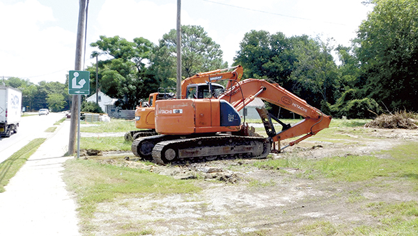 Construction equipment prepares for site work on a roadside lot in Chuckatuck where a Dollar General store is planned.