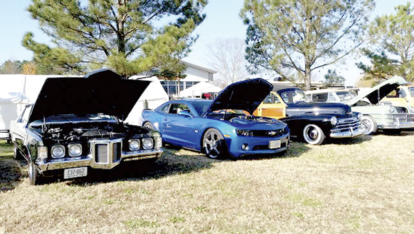 Antique and performance cars on display at Daniel Performance Group's sixth annual cruise-in last year.