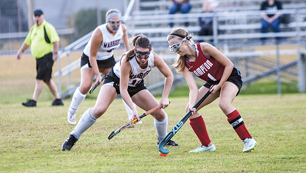 Nansemond River High School sophomore forward Ashlyn Rogers, left, looks to gain possession of the ball in an October 2015 game against Hampton High School. Rogers was recently selected for the AAU Junior Olympics U-16 field hockey team.
