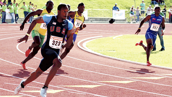Keith Ricks competes in the 200-meter race during the 2012 North American, Central American and Caribbean Athletics Association track championships in Mexico. Ricks recently re-aggravated an old injury and was not able to participate in last week's U.S. Olympic Trials in Oregon. (Courtesy of Keith Ricks)
