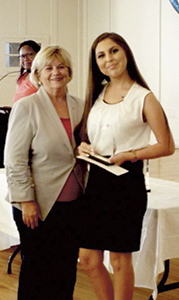 Mayor Linda T. Johnson presents Tala Hughes with a Youth Achievement Award on June 7 at the Planters Club. (Submitted Photo)