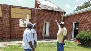 From left, A and B Custom Design employees Carl Britt, Curtis Ridley and Henry Baham survey the New Bethany United Church of Christ building.