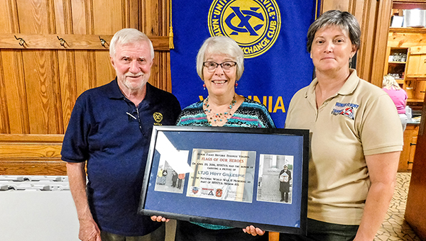 From left, Suffolk Exchange Club members Bob Moore and Caroline Grube are joined by HFTVA coordinator Martha Kastler during a recent Exchange Club meeting. Grube holds a glass plaque received through the Flags of Our Fathers program. The plaque commemorates her father and uncle, who were both World War II veterans.