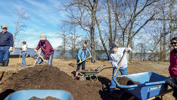 Volunteers plant trees and spread mulch at Sleepy Hole Park during a January volunteer project. Volunteers are needed again next weekend for a project at the same location.