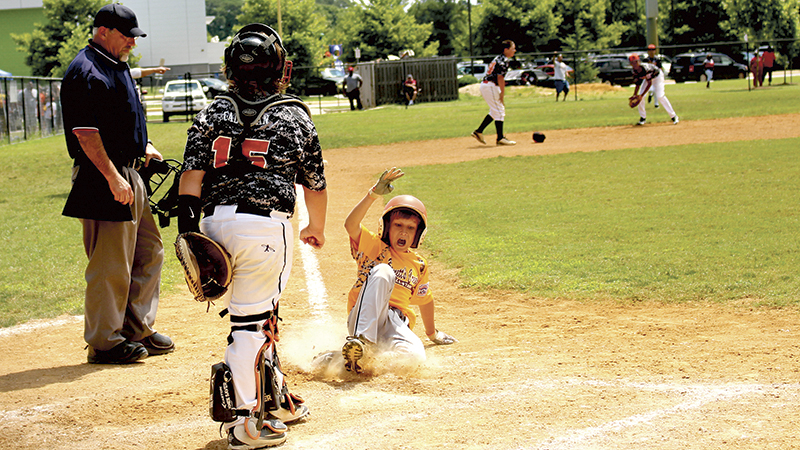 A Bennett's Creek Little League runner is safe at home. Bennett's Creek Little League is one of the many options available in Suffolk for fall ball every year.
