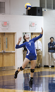 Senior Logan Harrell prepares to deliver a serve in a game last year. The Lady Saints won their first game for the 2016 season against Hampton Roads Academy on Tuesday.