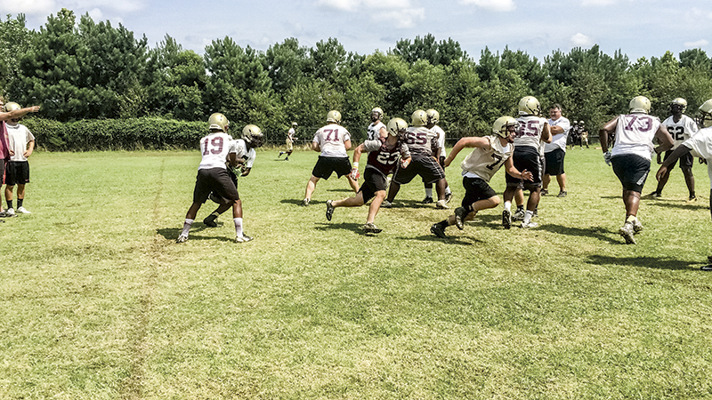 King's Fork High School drilled plays in preparation for the new season. The Bulldogs spent the morning practicing offense and defense before tackling special teams in the afternoon.