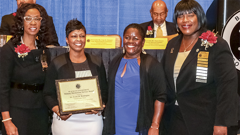 From left, B. Faye Stewart, Evette Washington, Denise Roberts and The Honorable Darlene Young are pictured at an awards ceremony in which Washington, an employee of the Naval Information Forces command in Suffolk, was honored with one of the annual Blacks In Government Military Meritorious Service Awards. Robert Fluegel/U.S. Navy
