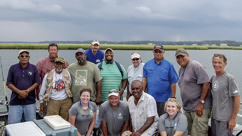 The Chesapeake Bay Foundation hosted a group of agricultural extension agents, farmers and professors traveled along the mouth of the Chesapeake Bay last Thursday and discussed agricultural management strategies. Roland Terrell, from left, is joined by Roy Flanagan, Dr. Lewis Martin, Jerome Williams, Matt Kowalski, Marcus Williams, Chris Moore, William Crutchfield, Clif Slade, Jimmy Sollner, Molly Graham, Yancey Powell, Glen Slade and Kayla Deur.