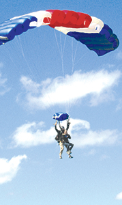 """Gold Star mother Sharon Patterson coasts to the ground at Skydive Suffolk on Saturday during the """"Jumping for a Purpose"""" event sponsored by Combat Wounded Coalition."""